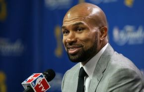 Derek-Fisher-in-gray-suit-smiles-after-game-3-in-Boston